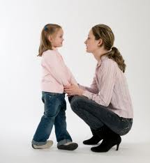 Child misbehaving mother talking to child